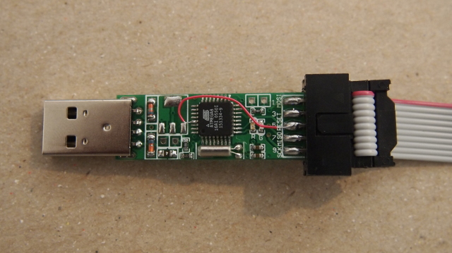 The guts of the programmer showing the temporary tiny wire modification